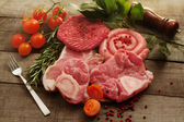 Raw meat selection over rough wood — Stockfoto