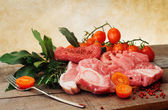 Raw meat selection with pink pepper and herbs — Stock Photo