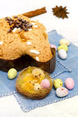 Dove with easter chocolates-colomba pasquale — Stock Photo