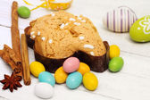 Easter dove with chosolate eggs — Stock Photo