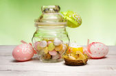 Easter little eggs inside vintage glass jar — Stock Photo