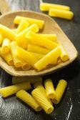 Raw macaroni over ardesia — Stock Photo