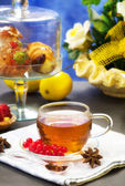 Rooibos tea with confectionery over blue background — Stok fotoğraf