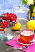 Red fruits tea with nerries background — Stock Photo