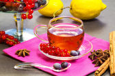 Red fruits tea with lemon and spices — Stock Photo