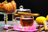 Tea time with croissant, lemon and cinnamon — Stock Photo