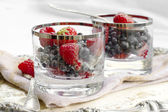 Red fruits dessert with vintage silverware — Stock Photo