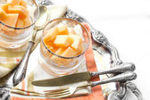 Melon desserts with vintage silverware — ストック写真