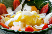 Delicious salad with melon, pineapple, datterino tomatoes and pa — Stock Photo