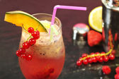 Pink coktail with redcurrant and melon — Stock Photo