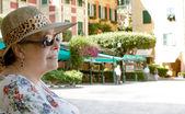 Obese senior female tourist visiting Portofino — Stock Photo