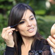 Attractive woman making up her eye — Stock Photo #9860086