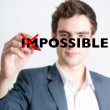 Man crossing out impossible concept — Stock Photo