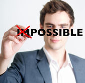 Man crossing out impossible concept — Stockfoto