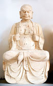 Wooden Buddha figure — Stock Photo