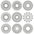 Set of rosettes, ornaments and decorative lines — Stock Vector
