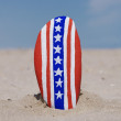 Vertical usa flag on a painted stone — Stock Photo