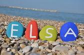 Elsa, female name on colourful stones — Stock Photo