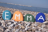 Emma, female name on colourful stones — Stock Photo