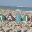 Stock Photo: Maria, female name on colourful stones