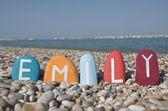 Emily, female name on colourful stones — Stock Photo