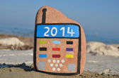 Happy New Year 2014 on a stone mobile — Stock Photo