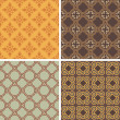 Collection of four decorative symmetric seamless patterns — Stock Vector #13423157