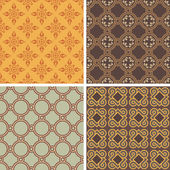 Collection of four decorative symmetric seamless patterns — Stock Vector