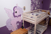 Colorful room with pony — Stock Photo