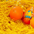 Easter eggs on a basket — Stock Photo