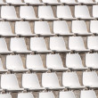 Empty white stadium chairs in a row — Stock Photo