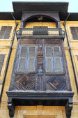 Old balcony and traditional wooden window. — Stock Photo