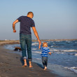 Father and son to the sea at sunset — Stock Photo
