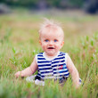 Portrait of a happy little girl in the park — Stock Photo #22181407