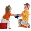Stock Photo: Little kids plays with cubes