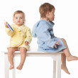 Beautiful kids preparing to brush their teeth wearing white bathrobes - isolated, closeup — Stock Photo #22317953