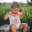 Little baby eating watermelon outdoors — Stock Photo