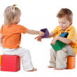 Little kids plays with cubes — Stock Photo