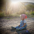 Portrait of a happy little girl in the park — Stock Photo #23906687