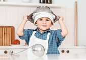 Portrait of a little chef hat and apron — Stock Photo