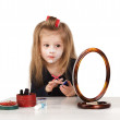 Child cosmetics. Little girl applying make up. — Stock fotografie