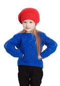 Kleines mädchen in eine rote kappe-lächeln — Stockfoto