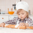 Happy little girl making pizza dough - Stock Photo