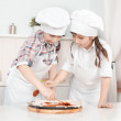 Little chef in the kitchen preparing food — Stock Photo