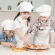 Children in clothes cooks — Stock Photo
