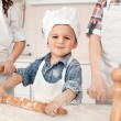 Happy little girl making pizza dough — Stock Photo