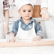 Little boy making pizza dough — Stock Photo