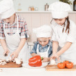 Young chef preparing vegetables in the kitchen — Stock Photo