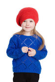 Little girl in a red cap smiles — Stock Photo