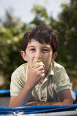 Cute kid holding red apple — Stock Photo